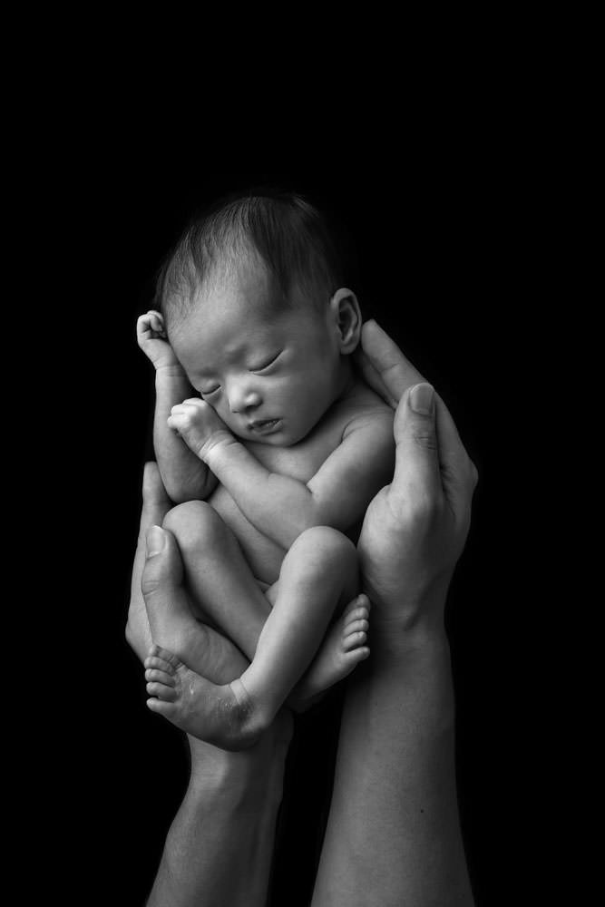 Choose a newborn photographer can take great shots and knows how to handle the baby well too